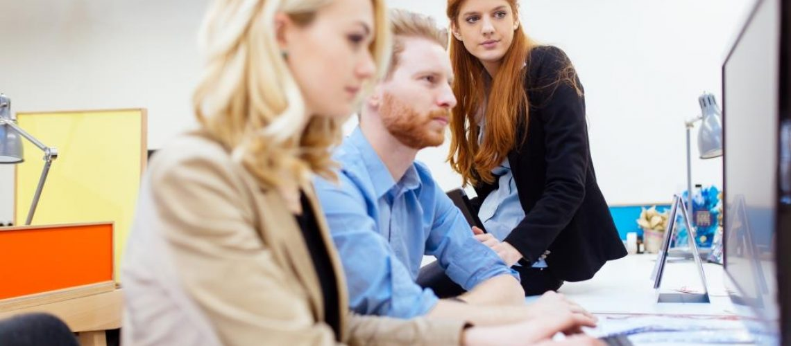 Businesspeople working in office and solving problems as a team