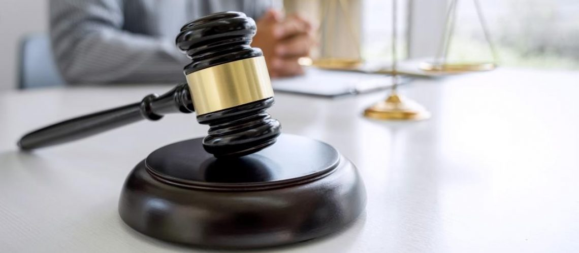 Judge gavel with Justice lawyers, Counselor in suit or lawyer working on a documents in courtroom, Legal law, advice and justice concept