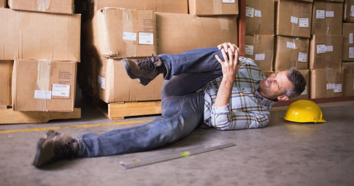 31910011 - side view of male worker lying on the floor in warehouse