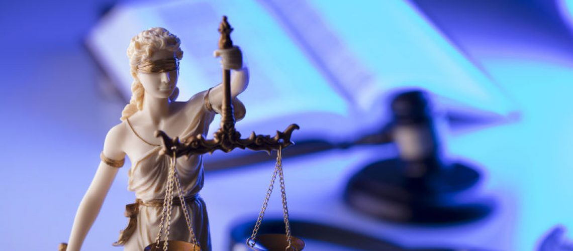 96130412 - medical law concept. statue of justice, gavel and stethoscope, blue light. place fort text.