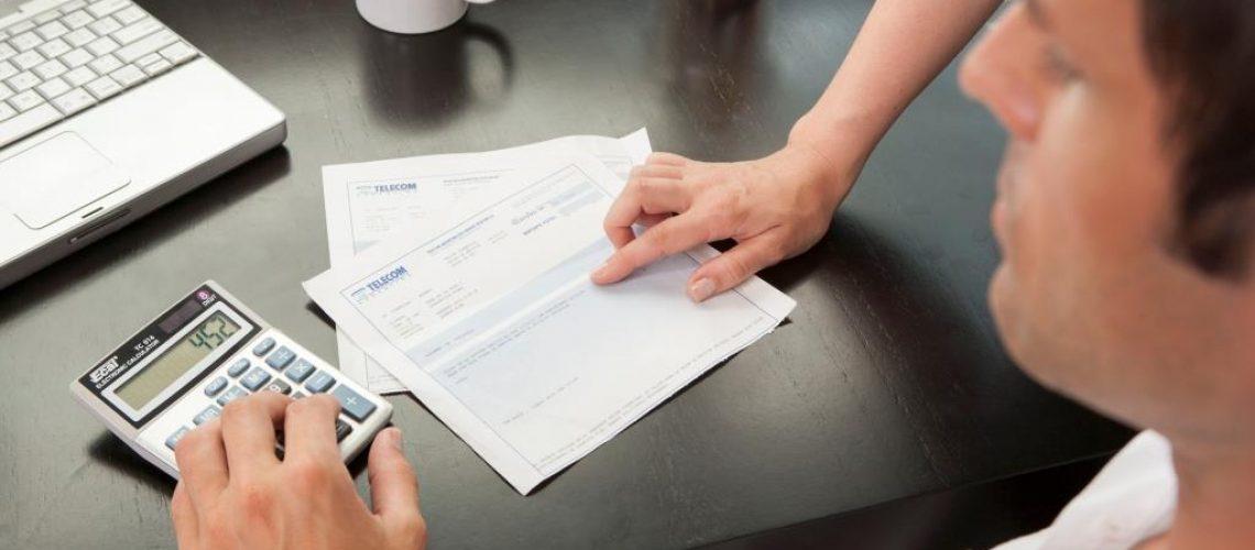 Hispanic couple managing finances